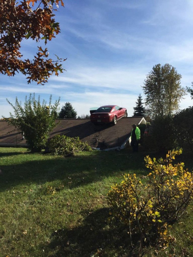Ford Mustang Lands on Roof